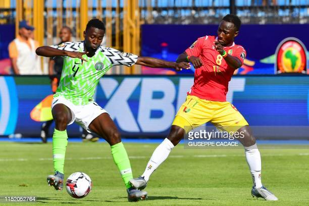 Nigeria's midfielder Wilfred Ndidi is marked by Guinea's midfielder Naby Keita during the 2019 Africa Cup of Nations football match between Nigeria...