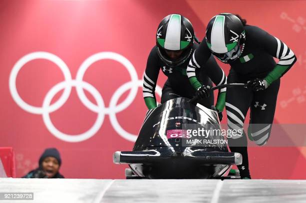 Nigeria's Moriam Seun Adigun and Nigeria's Akuoma Omeoga compete in the women's bobsleigh heat 1 run during the Pyeongchang 2018 Winter Olympic Games...