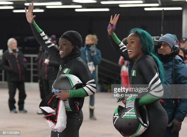 Nigeria's Moriam Seun Adigun and Nigeria's Akuoma Omeoga wave after the women's bobsleigh heat 2 run during the Pyeongchang 2018 Winter Olympic Games...