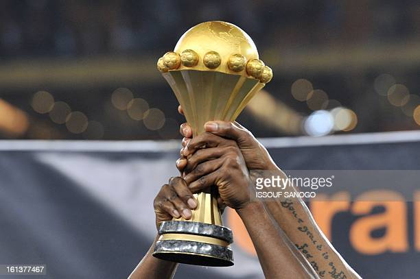 Nigeria's national football team players hold the trophy as they celebrate winning the 2013 African Cup of Nations final against Burkina Faso on...