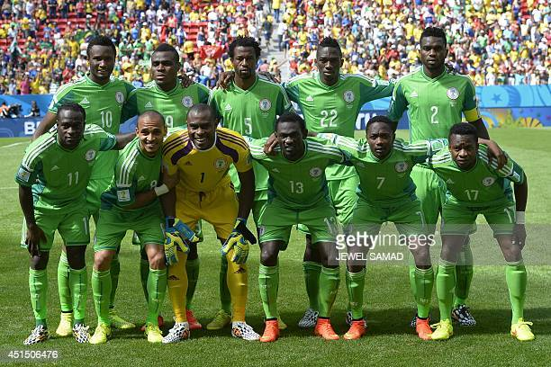 Nigeria's national team players pose for a picture prior to a Round of 16 football match between France and Nigeria at Mane Garrincha National...