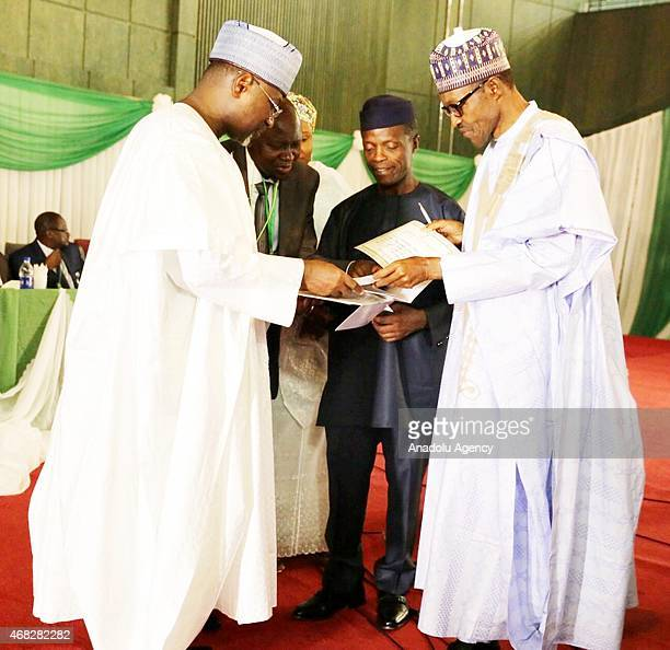 Nigeria's newly elected President Muhammed Buhari and vicepresident Yemi Osinbajo receive their certificates of election from Chairman of the...