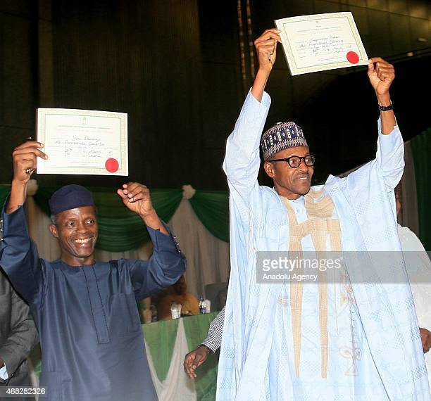 Nigeria's newly elected President Muhammed Buhari and vicepresident Yemi Osinbajo show their certificates of election after they received them from...