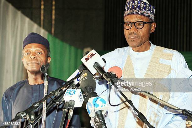 Nigeria's newly elected President Muhammed Buhari and vicepresident Yemi Osinbajo hold a joint press conference after they receives certificate of...
