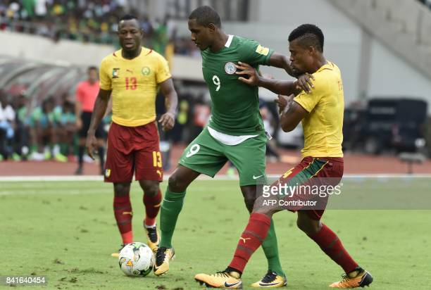 Nigeria's Odion Ighalo vies with Cameroon's players during the 2018 FIFA World Cup qualifying football match between Nigeria and Cameroon at Godswill...