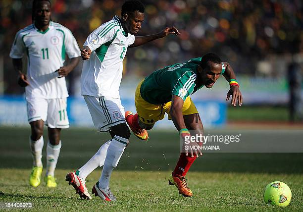 Nigeria's Ogu John fights for the ball with Ethiopia's Adane Girma on October 13 2013 during a 2014 World Cup qualifying match in Addis Ababa AFP...
