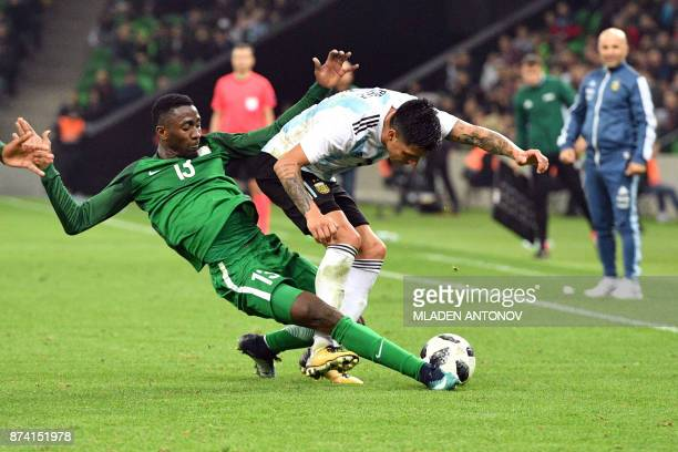 TOPSHOT Nigeria's Onyinye Ndidi and Argentina's Enzo Perez vie for the ball during an international friendly football match between Argentina and...