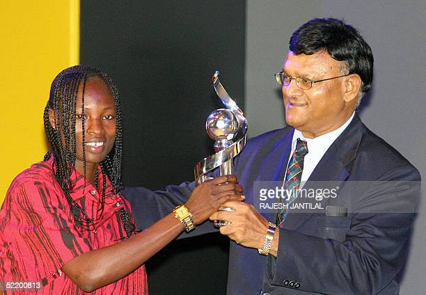 Nigeria's Perpetua Nkwocha receives the MTN Confederations of African Football Women Player of the Year award from the local Minister of Sport...