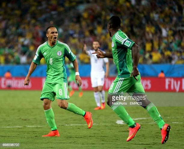 Nigeria's Peter Odemwingie celebrates scoring his teams opening goal alongside teammate Emmanuel Emenike