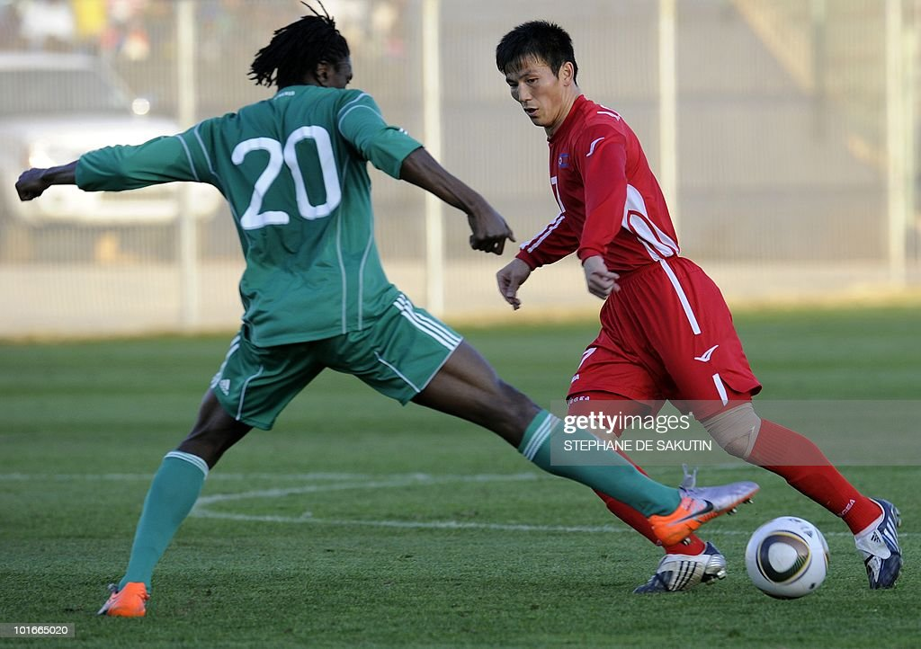 Nigeria's player Dickson Etuhu (L) fights for the ball with North Korea's player An Chol-Hyok during their international friendly football match at Makhulong stadium on June 6, 2010 in Tembisa . The 2010 FIFA World Cup football championship is due to take place in South Africa from June 11 to July 11 of 2010.
