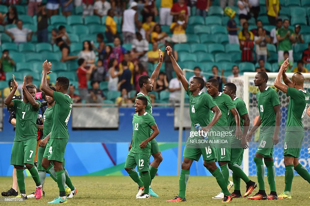 Nigeria's players celebrate after defeating Denmark in their Rio 2016 Olympic Games mens quarter-final football match Nigeria vs Denmark, at the Arena Fonte Nova Stadium in Salvador, Brazil on August 13, 2016. / AFP / NELSON