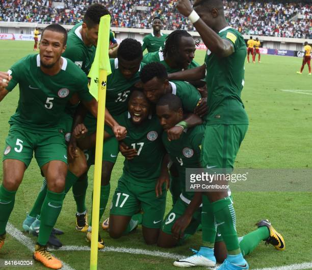Nigeria's players celebrate after scoring a goal during the 2018 FIFA World Cup qualifying football match between Nigeria and Cameroon at Godswill...
