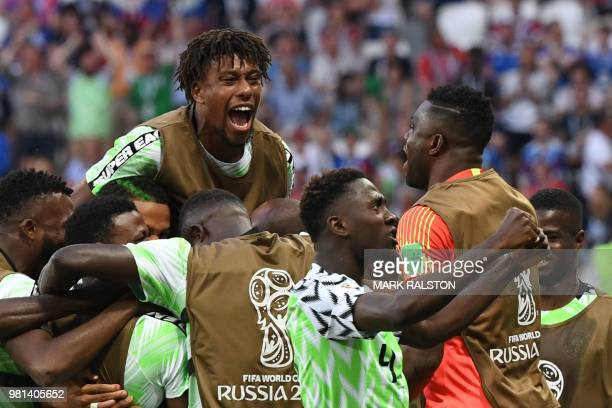 Nigeria's players celebrate after scoring their opener during the Russia 2018 World Cup Group D football match between Nigeria and Iceland at the...