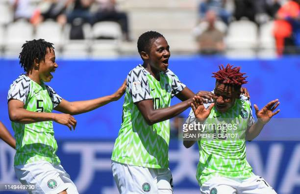 TOPSHOT Nigeria's players celebrate after South Korea scored an own goal during the France 2019 Women's World Cup Group A football match between...