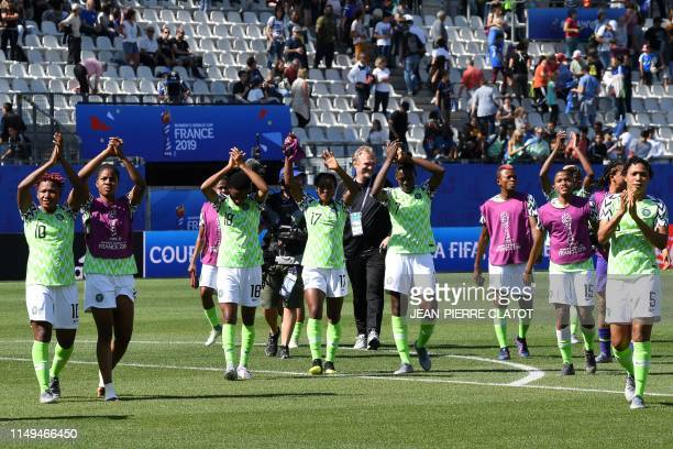 Nigeria's players celebrate after winning the France 2019 Women's World Cup Group A football match between Nigeria and South Korea on June 12 at the...