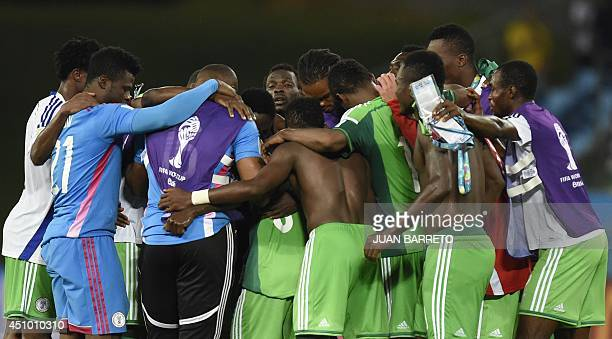 Nigeria's players celebrate at the end of the Group F football match between Nigeria and BosniaHercegovina at the Pantanal Arena in Cuiaba during the...