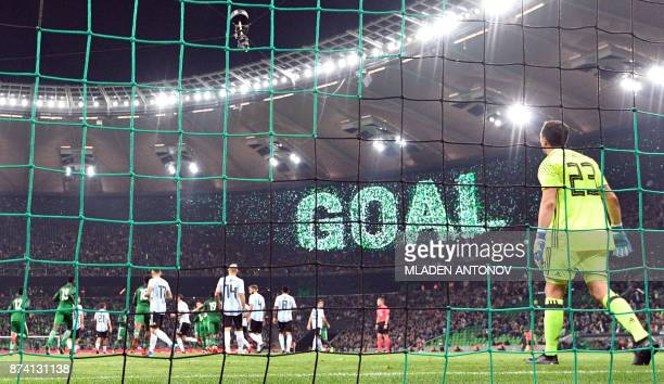 Nigeria's players celebrate the team's first goal during an international friendly football match between Argentina and Nigeria in Krasnodar on...