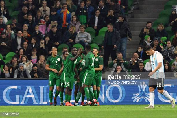 TOPSHOT Nigeria's players celebrate the team's second goal during an international friendly football match between Argentina and Nigeria in Krasnodar...