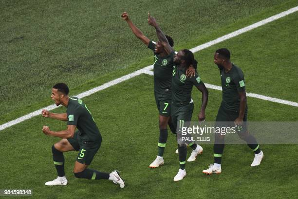 TOPSHOT Nigeria's players celebrate their equalising goal during the Russia 2018 World Cup Group D football match between Nigeria and Argentina at...