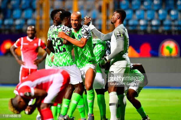 Nigeria's players celebrate their victory during the 2019 Africa Cup of Nations football match between Nigeria and Burundi at Alexandria Stadium on...
