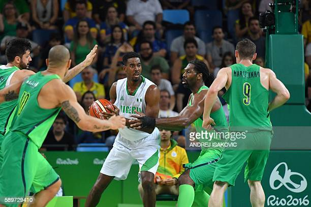 Nigeria's power forward Alade Aminu is cornered by Brazil's power forward Guilherme Giovannoni Brazil's small forward Alex Garcia Brazil's centre...