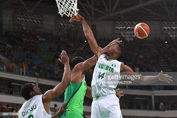 Nigeria's power forward Ike Diogu Brazil's centre Nene Hilario and Nigeria's power forward Alade Aminu go for a rebound during a Men's round Group B...