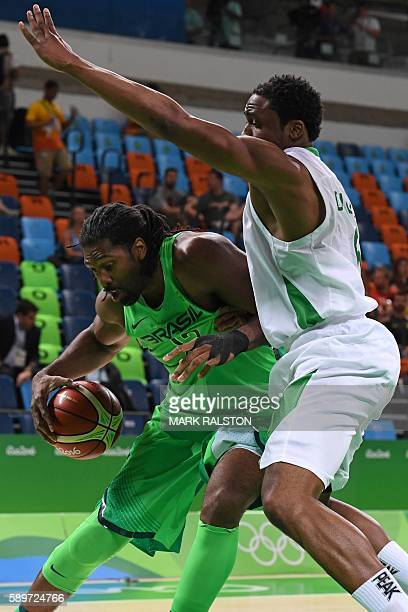 Nigeria's power forward Ike Diogu holds off Brazil's centre Nene Hilario during a Men's round Group B basketball match between Nigeria and Brazil at...