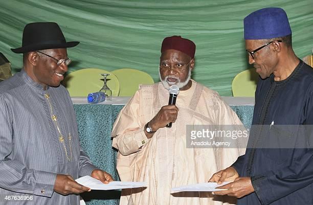 Nigeria's President Goodluck Jonathan and opposition candidate Gen. Muhammadu Buhari, listen as Abdulsalami Abubakar former President of Nigeria...