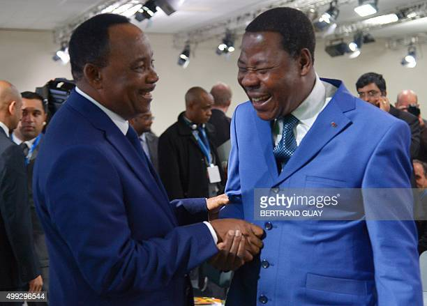 Nigeria's President Mahamadou Issoufou shares a joke with Benin's President Thomas Boni Yayi during the COP21 World Climate Change Conference in Le...