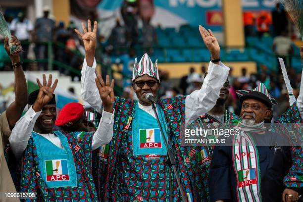 Nigeria's President Muhammadu Buhari and member of the ruling party All Progressive Congress waves at the crowd of APC supporters upon his arrival...