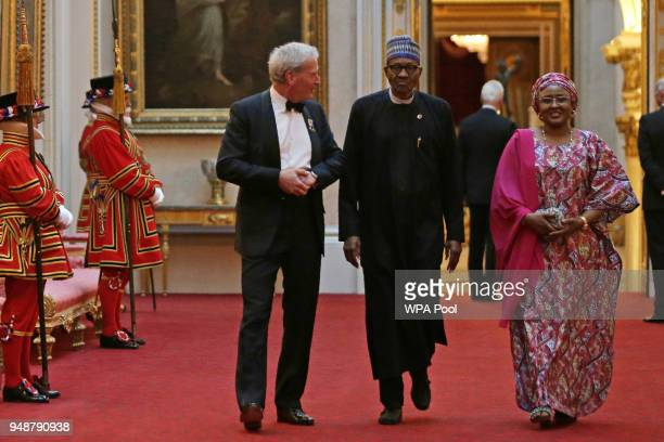 Nigeria's President Muhammadu Buhari arrives to attend The Queen's Dinner during The Commonwealth Heads of Government Meeting at Buckingham Palace on...