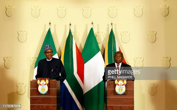 Nigeria's President Muhammadu Buhari gives a joint press conference with South Africa's President Cyril Ramaphosa during his official state visit at...