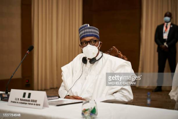 Nigeria's President Muhammadu Buhari is seen after a meeting in Bamako on July 23, 2020 as West African leaders gather in a fresh push to end an...