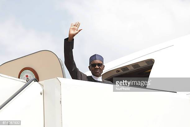 Nigeria's president Muhammadu Buhari leaves as he eaves for Germany at the Nnamdi Azikiwe International airport Abuja Nigeria October 13 2016