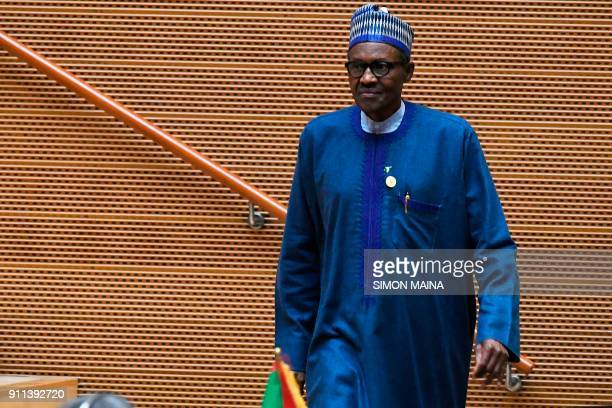 Nigeria's President Muhammadu Buhari walks after speaking at the opening of the Ordinary Session of the Assembly of Heads of State and Government...