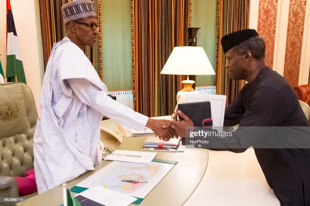 Nigeria's president Muhammadu Buhari welcomes Vice President Yemi Osinbajo in his office as he resumes work in Abuja, Nigeria, on March 13, 2017.