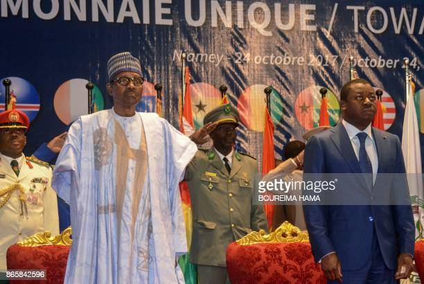 Nigeria's Presidents Muhammadu Buhari and Togo's President Faure Gnassingbe attend the opening of a summit of heads of state of the Economic...