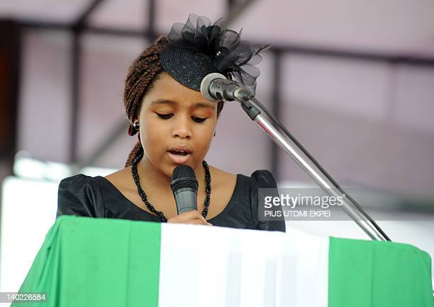 Nigeria's secessionist leader Odumegwu Ojukwu's 10yearold daugther Chineme reads the Bible during the national interdenominational funeral rites at...