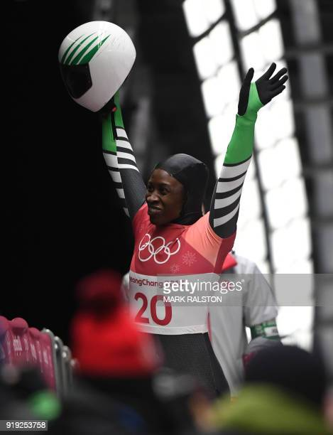 Nigeria's Simidele Adeagbo celebrates after finishing the women's skeleton heat 3 run during the Pyeongchang 2018 Winter Olympic Games at the Olympic...