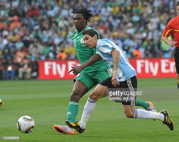 Nigeria's striker Ideye Brown fights for the ball with Argentina's midfielder Angel Di Maria during their Group B first round 2010 World Cup football...