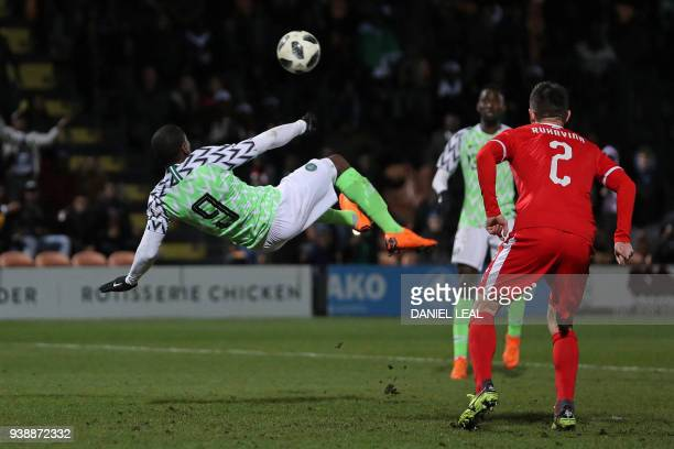Nigeria's striker Odion Ighalo attempts an overhead bicycle kick during the International friendly football match between Nigeria and Serbia at the...