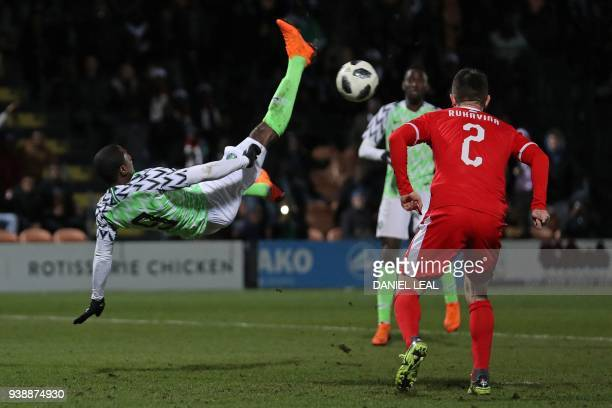 TOPSHOT Nigeria's striker Odion Ighalo attempts an overhead bicycle kick during the International friendly football match between Nigeria and Serbia...