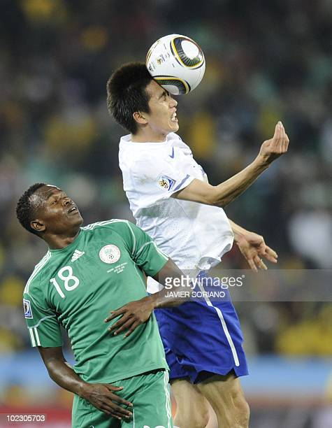 Nigeria's striker Victor Obinna Nsofor looks on as South Korea's midfielder Kim JungWoo heads the ball during the Group B first round 2010 World Cup...