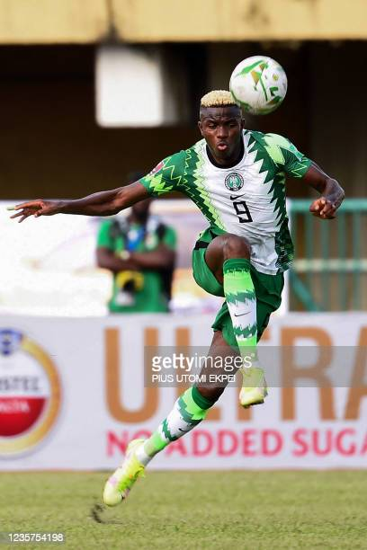 Nigeria's striker Victor Osimhen kicks the ball during the 2022 Qatar World Cup African qualifiers group 3 football match between Nigeria and Central...