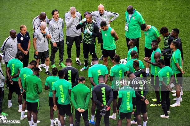 Nigeria's team players gather to pray ahead of a training session of Nigeria's national football team at the Saint Petersburg Stadium in Saint...