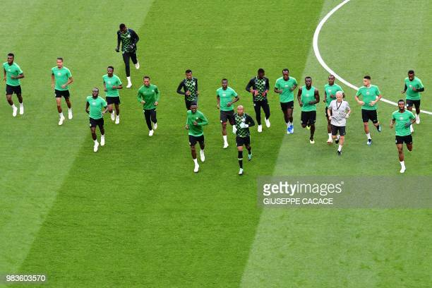 Nigeria's team players warm as they take part in a training session of Nigeria's national football team at the Saint Petersburg Stadium in Saint...