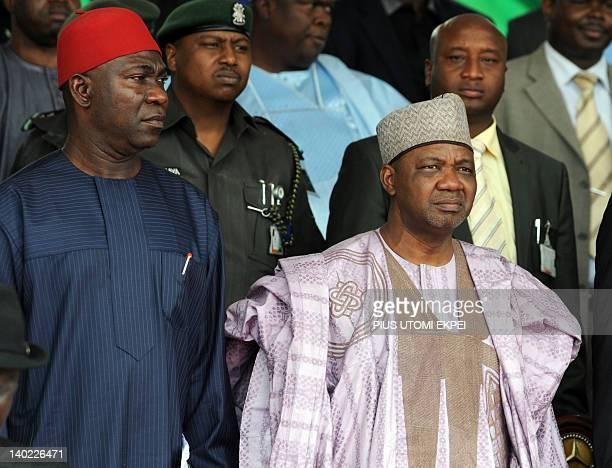 Nigeria's Vice President Namadi Sambo and Deputy President of the Senate Ike Ekweremadu stand for the national anthem during the national...