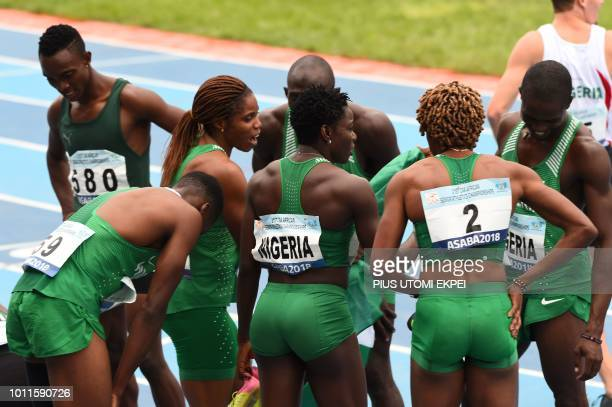 Nigeria's women's 4x400m relay gold medalists celebrate with their male teammate who won bronze at the men's 4x400m relay of the African Athletics...