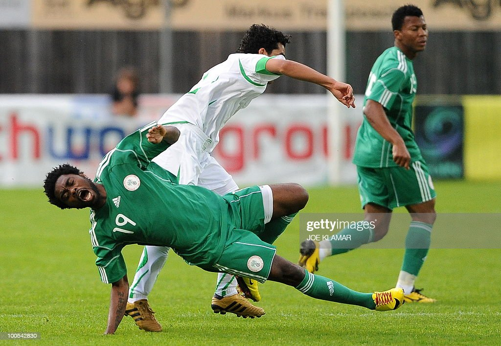 Nigeria's Yusuf Mohamed and Saudi's Ahmen Ibrahim Ateef tangle during their friendly match between Saudi Arabia and Nigeria in Alpen stadium in Tyrolian Wattens on May 25, 2010 prior to the FIFA World Cup 2010 hosted by South Africa.