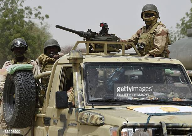 Nigerien army forces patrol in pickup trucks near Malam Fatori on April 3 after the town in northeastern Nigeria was retaken from Boko Haram by...